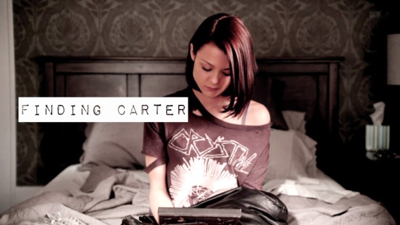 Finding Carter poster typing laptop
